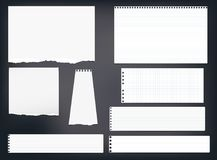 Ripped note, notebook, copybook paper strips, sheets stuck on black background. Royalty Free Stock Images