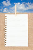 Ripped Off Paper With Wooden Clothespin On Burlap In Front. Royalty Free Stock Photo