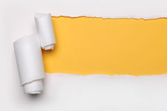 Ripped Paper. With yellow hart's shape and on a white background stock photo