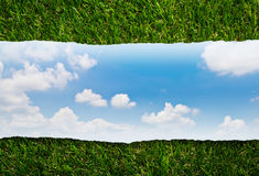 Ripped paper  with blue sky on green grass Stock Images