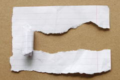 Ripped paper on brown background Stock Photo