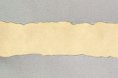 Ripped paper on brown background. Ripped red hard on brown paper Stock Image