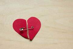 Ripped paper heart put back together Royalty Free Stock Photo
