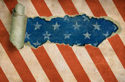 Ripped paper hole in grunge USA flag. Background Royalty Free Stock Photo