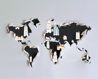 Ripped paper map with city icons Royalty Free Stock Photo