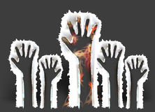 Ripped paper raising hands and flames Royalty Free Stock Images
