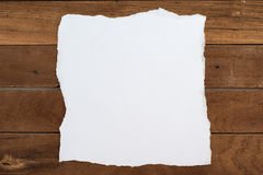 Ripped paper on Wood for background. Ripped paper on Wood for text Stock Image