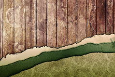 Ripped paper and wood panel Royalty Free Stock Image