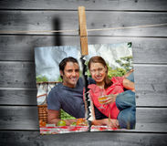 Ripped photo of couple hung with a peg. On washing line with wooden boards on the background royalty free stock photos