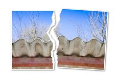Ripped photo of a dangerous asbestos roof - concept image Royalty Free Stock Photos