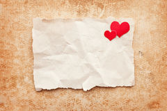Ripped piece of paper. Love letter. Ripped piece of paper on grunge paper background. Love letter Stock Image