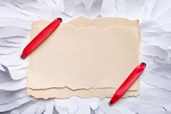Ripped piece of paper with red ribbon. Royalty Free Stock Photography