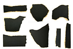 Ripped pieces of paper. Collection of black ripped pieces of paper on white background Royalty Free Stock Photo