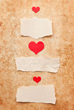 Ripped pieces of paper on grunge background. Ripped pieces of paper on grunge paper background. Love letter.Valentine's Day Royalty Free Stock Images