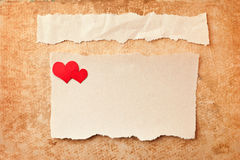 Ripped pieces of paper on grunge background. Ripped pieces of paper on grunge paper background. Love letter Stock Photos