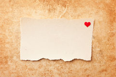 Ripped pieces of paper on grunge paper background. Ripped piece of paper on grunge paper background. Love letter Stock Images