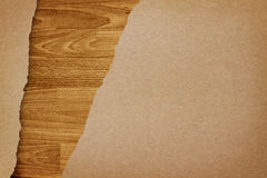 Ripped recycle paper on wood background Royalty Free Stock Images
