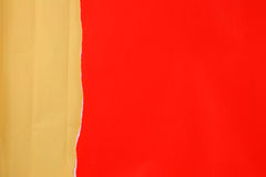 Ripped red paper with crinkled brown paper. For background Royalty Free Stock Images