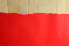 Ripped red paper with crinkled brown paper. For background Stock Images