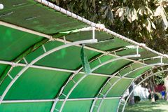 Ripped retro vinyl green roof in park royalty free stock photography