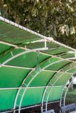 Ripped retro vinyl green roof in park stock photography