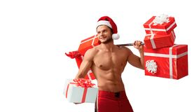 Ripped Santa Claus holding barbell and giving presents Stock Photos