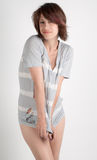 Ripped Shirt. An image of a cute young woman in a ripped t-shirt Stock Photos