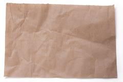 Ripped skrynklade stycken av förpackande papper   på vit Arkivbild