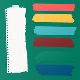 Ripped squared blank note paper, colorful sticky, adhesive tapes are stuck on green wall Stock Photo