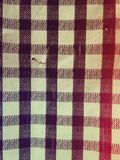 Ripped table cloth with checkered pattern Royalty Free Stock Image