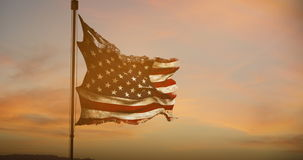 Ripped tear grunge old closeup of american USA flag waving , stars and stripes, united states of america, at sunset stock video