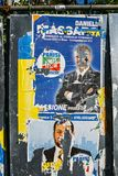 Ripped up defaced billboards ahead of 2018 Italian general election is due to be held on March 4th, 2018. Milan, Italy - Feb 13, 2018: Ripped up defaced Royalty Free Stock Photography