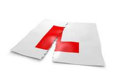 Ripped up L plates. A 3D illustration of driving L plates having been ripped in two Royalty Free Stock Images