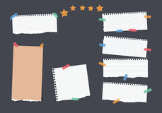 Ripped white, brown note, notebook, copybook, ruled paper strips stuck with colorful sticky tape, stars on black. Background Royalty Free Stock Image