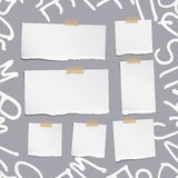 Ripped white note, notebook, copybook paper sheets on pattern created of alphabet letters.  Royalty Free Stock Photos