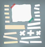 Ripped white notebook, copybook, note paper, sticky, adhesive masking tape stuck on gray background Royalty Free Stock Image