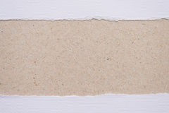 ripped white paper on brown background royalty free stock photos