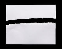 Ripped white paper isolated on black background Royalty Free Stock Photo