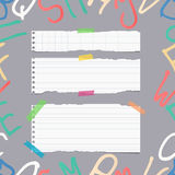 Ripped white ruled note, notebook, copybook paper sheets, strips. On pattern created of alphabet letters Stock Photo