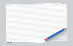 Ripped white ruled notebook paper sheet are on gray background with blue wooden pencil Royalty Free Stock Images