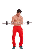 Ripped young man lifting a barbell Stock Photos