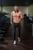 Ripped Young Man In Modern Fitness Center Royalty Free Stock Photography