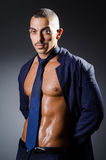 The ripped young man in studio concept Stock Images