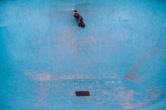 Ripping a pool. A kid skating an empty pool Royalty Free Stock Image