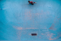 Ripping a pool. A kid skating an empty pool Stock Photography