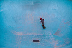 Ripping a pool. A kid skating an empty pool Royalty Free Stock Photos