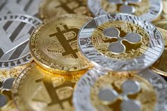 Ripple, bitcoin and litecoin on one heap. stock photography