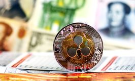 Ripple coin against of different banknotes on background. stock photography