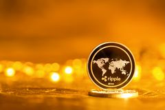 Ripple cryptocurrency coin. On a bright gold background Stock Photography