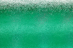 Ripple glass. Corrugated and translucent glass of window - green colored Royalty Free Stock Image